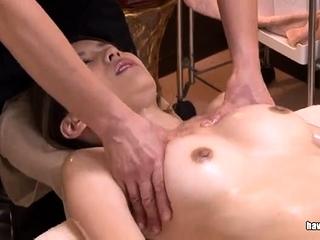 Japanese slut sucking on a hairy asian cock