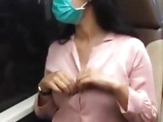 Philipino girl showing boobs in public bus in hk
