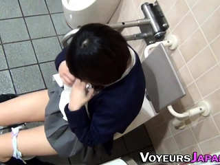 Brunette uniformed asian teenager